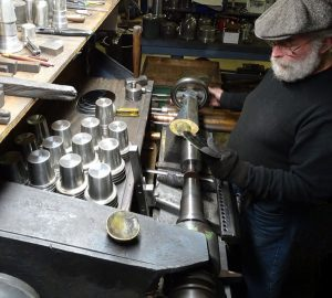 Silver spinner manufacturing mint julep cups